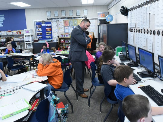 Pedro Rivera, center, Pa. education secretary, observes students in a 4th grade classroom at Greencastle-Antrim Elementary School on Tuesday, February 14, 2017. Sec. Rivera was in Greencastle for the Schools That Teach tour.