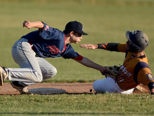 Pleasureville's Ryan Pepler, left, puts the tag on
