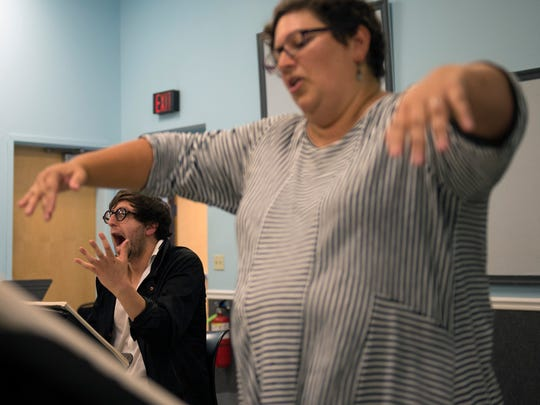 Composer David Hertzberg, left, reacts as maestra Liz Braden conducts a rehearsal for 'The Wake World' with the Philadelphia Opera at the Prince Theatre in Philadelphia.