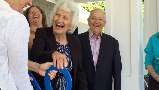 Philanthropists Lois McClure, center left, and Bob Miller, center, laugh after a ribbon-cutting ceremony Monday at the new McClure Miller VNA Respite House in Colchester.