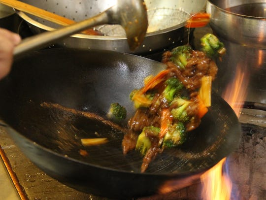 Owner and chef Tony Chang prepares beef and broccoli