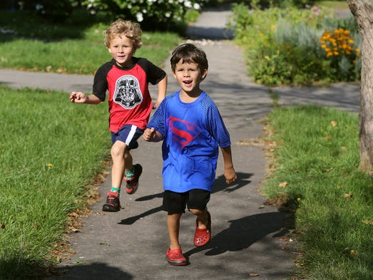 Schuyler Peck, 5, right, and his twin brother, Asa,