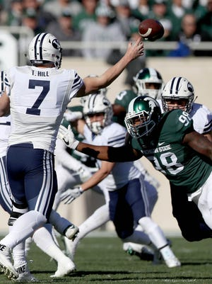 Michigan State Spartans Demetrius Cooper rushes BYU Cougars Taysom Hill.