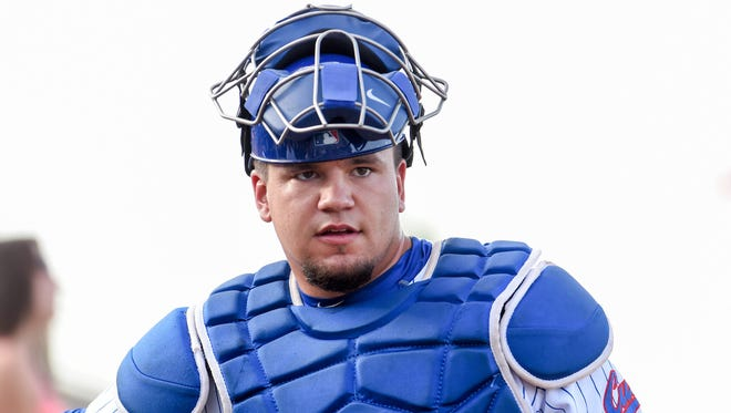 Iowa Cubs catcher Kyle Schwarber (17) greets a fan before the of the game between the Iowa Cubs and the Omaha Storm Chasers at Principal Park.
