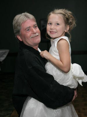 The family of Brian Lukaszewski have started a GoFundMe page to raise funds for the 48-year-old diagnosed with colon cancer. Brian is pictured here with his granddaughter, Lily.