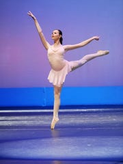 An ACAA dancer demonstrates elegant moves that are