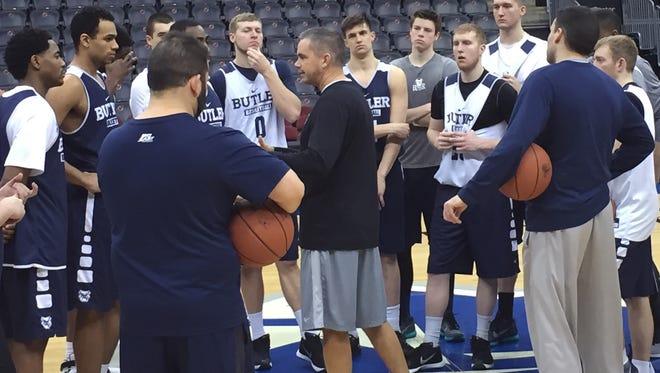 Coach Chris Holtmann, center, address Butler's team after a Wednesday morning shootaround at the Prudential Center.