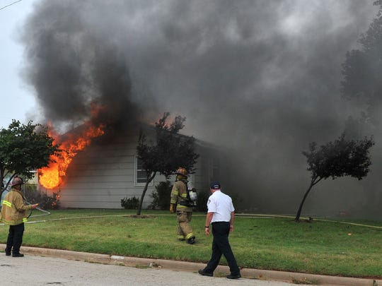 The Wichita Falls fire department works the scene of