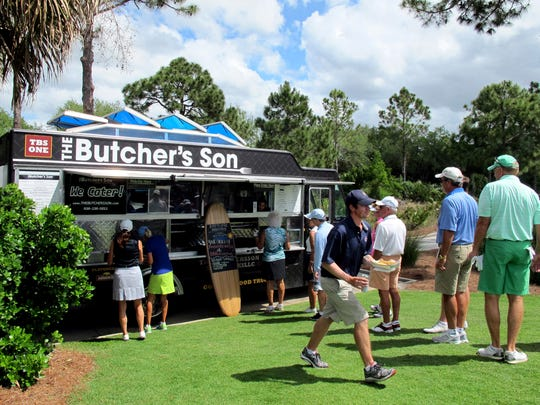 The Butcher's Son food truck, co-owned by Jon Wagner of Naples, serves hot dogs, brats and veggie sandwiches April 18, 2016, to golfers during Caddy Appreciation Day at The Old Collier Golf Club in North Naples.