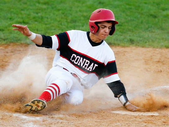 Conrad's Kevin Russo scores in the first inning against