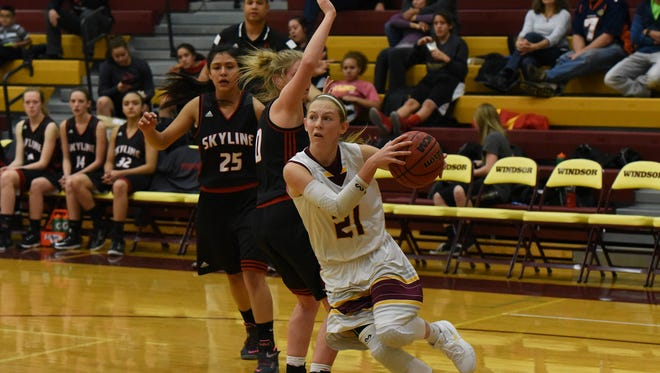 Windsor sophomore guard Michaela Moran drives toward the basket against Skyline and scores 2 of her 6 points during the second quarter Saturday night.  Windsor won 62-20.