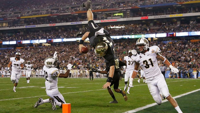 Baylor quarterback Bryce Petty dives head-over-heels for a 13-yard rushing touchdown against Central Florida in the second quarter at the 43rd Tostitos Fiesta Bowl in Glendale, Ariz.