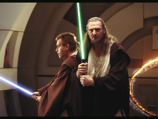 Ewan McGregor and Liam Neeson in a scene from 'The Phantom Menace.'  The film features the earliest appearance of lightsabers.