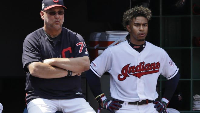 Cleveland Indians manager Terry Francona, left, and Francisco Lindor watch in the second inning in a baseball game against the Boston Red Sox, Wednesday, Aug. 14, 2019, in Cleveland.