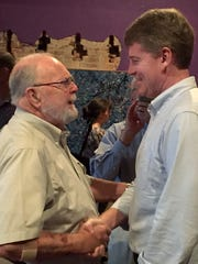 Springfield resident Jack Hembree shakes hands with