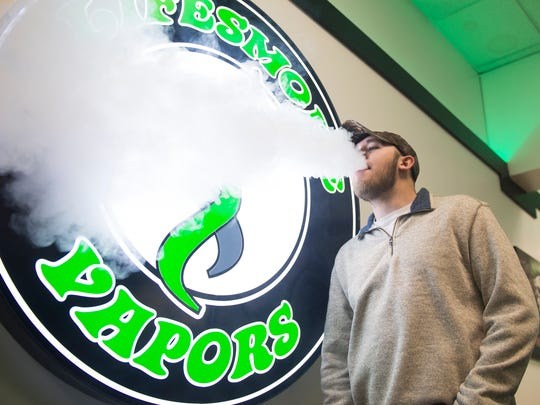 Trey Parrish, an employee at LifeSmoke Vapors in Hanover, blows out a vape cloud on Friday, Jan. 27, 2017. Parrish said he enjoys helping customers kick cigarette habits by introducing them to vapor products. In October, a 40 percent tax on all vape merchandise went into effect in Pennsylvania -- causing more than 100 vape businesses to close, with more than 50 expected to shutter in 2017 if the tax is not changed, according to John Dietz, vice president of the Pennsylvania Vaping Association.