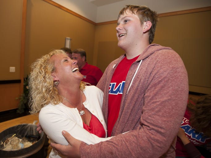 Marla Clark celebrates her win with a hug from her son, Max Clark, 15, on Tuesday, May 6, 2014, at Franklin College in Franklin, Ind.  Clark was running against Joe Villanueva for Judge of Johnson County Superior Court 4.