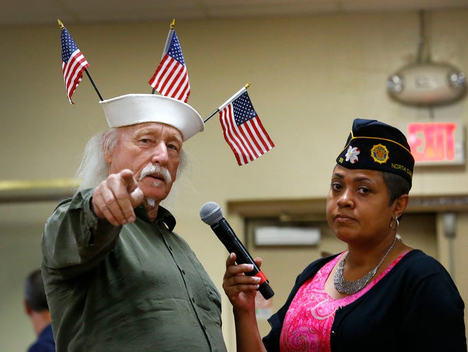 U. S. Navy veteran Louis Albin speaks with moderator Verna Jones during a town hall meeting about the VA health-care crisis  on June, 9,  2014 at American Legion Post 1 in Phoenix.