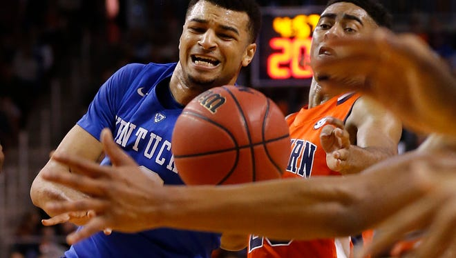 Auburn guard TJ Lang, right, and Kentucky guard Jamal Murray, left, both wrestle for the rebound during the first half of an NCAA college basketball game, Saturday, Jan. 16, 2016, in Auburn, Ala.