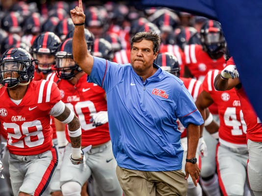 FILE - In this Sept. 2, 2017, file photo, Mississippi head coach Matt Luke leads the team onto the field for the game against South Alabama at Vaught-Hemingway Stadium in Oxford, Miss.  A week after No. 1 Alabama (4-0, 1-0 Southeastern Conference) crushed an undefeated Vanderbilt team, Ole Miss comes to town having scored 109 points against the Crimson Tide over the past three years, by far the most of any opponent. (Bruce Newman/The Oxford Eagle via AP, File)