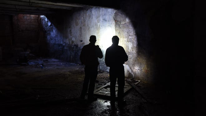Brad Preston and Carl Fernyak explore the manmade tunnels between North Daimond and North Franklin streets just north of Fourth Street.