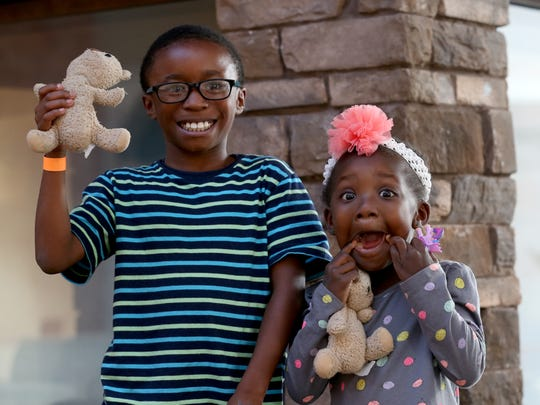 Ruthie Drew and her brother Darius Drew hold up the pair of reunited bears. On Monday, Ruthie got back the bear that had been lost  at Eastview Mall months ago.