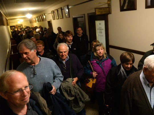 Great Falls residents file into the City Commission chambers ahead of Tuesday night's scheduled meeting where the city commission read a proclamation expressing opposition to the white supremacist activity in Whitefish.