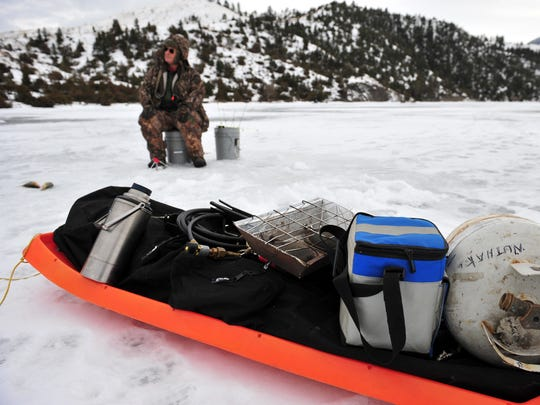 Fred Nemec brought a sled full of ice fishing gear to Holter Lake last week.