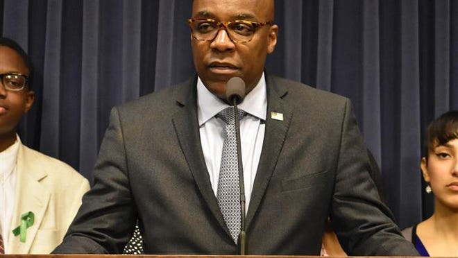 Attorney General Kwame Raoul, pictured in a file photo last year at the Illinois State Capitol, announced Tuesday he has tested positive for COVID-19.