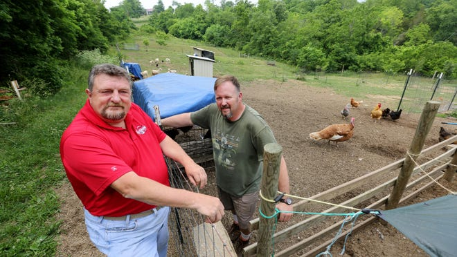 Bill Schneider, left, and Scott Daniels at Daniels' farm in South Kenton County, Kentucky. Schneider has a 71- acre farm nearby, mostly with timber. Schneider is one of the original members of the South Kenton County Committee. The committee wants to protect the rural heritage of the this part of the county, which is unincorporated.