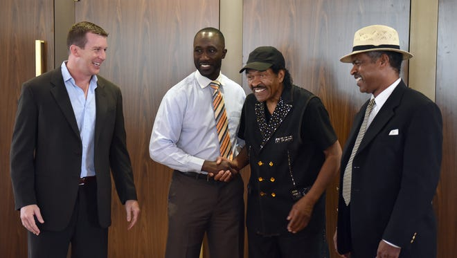Speakers at a meeting Thursday about the first We Are Jackson concert series, (from left) Ted DiBiase Jr., Jackson Mayor Tony Yarber, blues musician Bobby Rush and Malcolm Shepherd with the Central Mississippi Blues Society, laugh as they pose for photos at Thalia Mara Hall in Jackson.