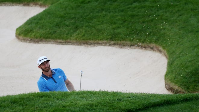 Dustin Johnson hits out of a bunker on the 13th hole during the third round of the U.S. Open golf tournament at Oakmont Country Club.