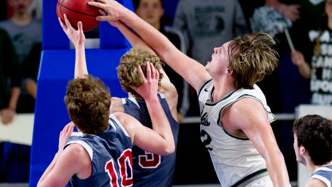 North Greene's Elijah Smith (42) blocks a shot by Oakdale's Dawson Smith (5) during a Division I Class A quarterfinals game between Oakdale and North Greene at the TSSAA boys state basketball championships at the Murphy Center in Murfreesboro, Tennessee on Wednesday, March 14, 2018.