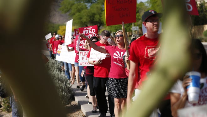 Teachers protest outside the KTAR studios in Phoenix on April 10, 2018. This was the second time the group protested outside one of Gov. Doug Ducey radio appearances at KTAR.