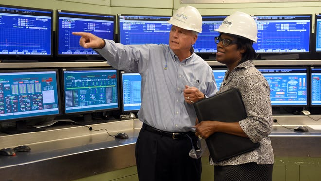 Big Rivers CEO Bob Berry shows the control room to Kentucky Lt. Gov. Jenean Hampton as she takes a tour of the Sebree station in Robards Wednesday.  Hampton made several stops in Western Ky., including Big Rivers.