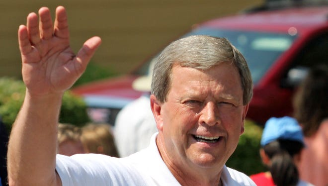 U S Congressman Tom Latham (Rep) waves to the crowd during the patriotic Fourth of July parade along 70th St in Urbandale as they celebrate America's independence.