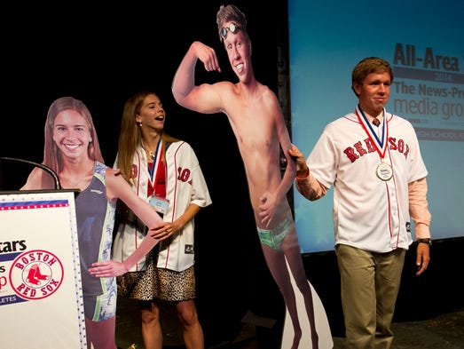 Emily Edwards, left, and Logan Samuelson, right, show their life-sized cutouts after being named The News-Press 2014 All-Area Athletes of the Year on Tuesday at the Broadway Palm Dinner Theatre in Fort Myers.