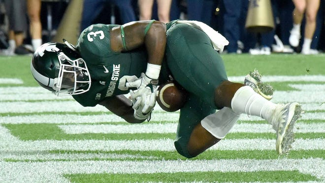 Spartan LJ Scott loses control of the ball in the end zone in the second quarter for a touchback.