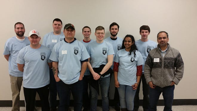 Members of the St. Cloud State University information technology security program pose at the 2016 Minnesota Collegiate Cyber Defense Competition. St. Cloud State won and will compete at the Midwest Regional CCDC in April.