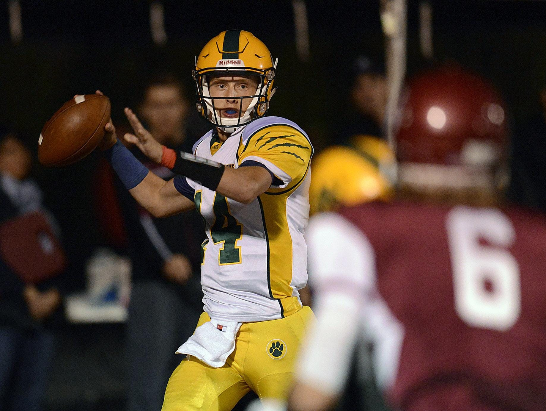 Ashwaubenon senior quarterback Will Ark (14) is tied for the Fox River Classic Conference lead with 21 touchdown passes this season.