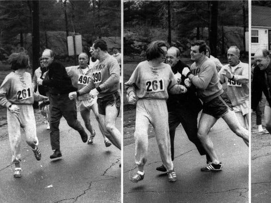 Kathrine Switzer (261) is defended by Thomas Miller (390) as race official Jock Semple tried to forcibly remove Switzer from the then all-male Boston Marathon on April 19, 1967.