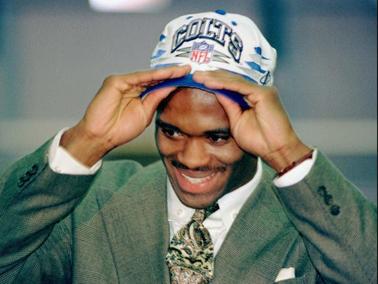 -  -Indianapolis Colts first-round draft pick Marvin Harrison, a wide receiver from Syracuse, tries on a Colts cap in the Colts locker room while meeting with the media and conducting his first round of interviews on Sunday, April 21, 1996, in Indianapolis. (AP Photo/The Indianapolis Star and The Indianapolis News, D. Todd Moore)