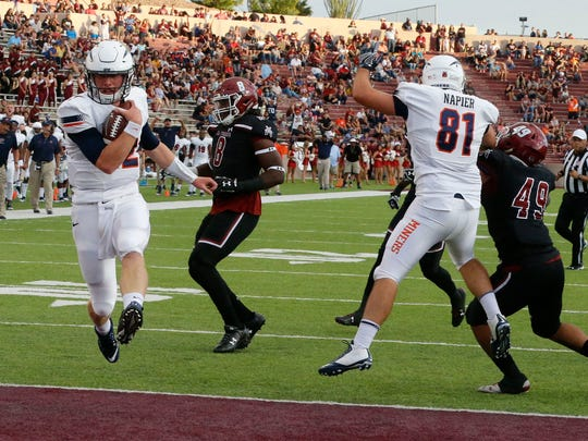 UTEP quarterback Ryan Metz runs the ball in to score for the Miners during the first half of action Saturday in Las Cruces.