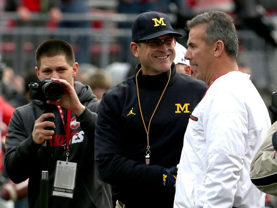 Michigan coach Jim Harbaugh and Ohio State coach Urban