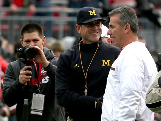 Michigan coach Jim Harbaugh and Ohio State coach Urban Meyer shake hands at midfield before the game at Ohio Stadium in Columbus, Ohio on Nov. 26, 2016.