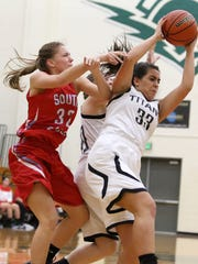 West Salem's Riley Gunesch (33) fights for the ball with South Salem's Erin McNally during their game.