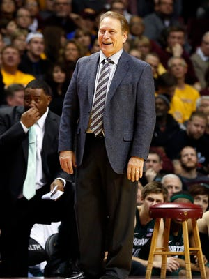 Michigan State head coach Tom Izzo manages a smile during the second half of an NCAA college basketball game against Minnesota, Tuesday, Dec. 27, 2016, in Minneapolis where Michigan State came from behind to beat Minnesota 75-74 in overtime. (AP Photo/Jim Mone)
