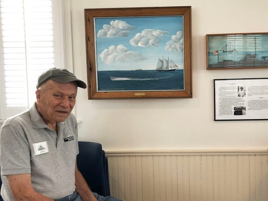 """Volunteers Stuart Preston and Isabel Westerlind enjoy the new art exhibit """"A Brush Stroke in Time,"""" paintings by Curt Whiticar, at the House of Refuge Museum."""