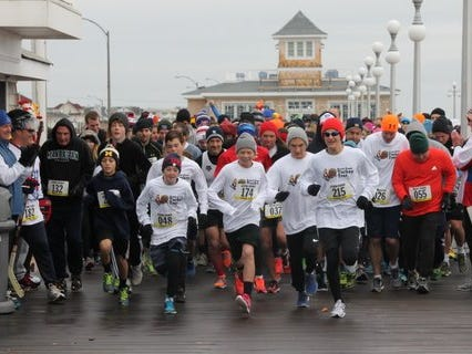 Runners took to the boards for the first Avon Pond Turkey Trot in 2014.