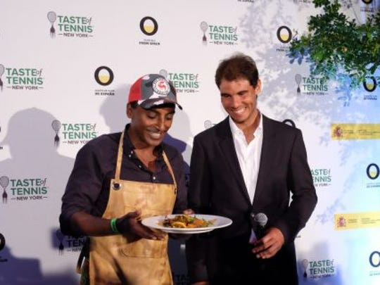 Chef Marcus Samuelsson on left and tennis pro Rafael Nadal on right at the 2016 Taste of Tennis event in New York.